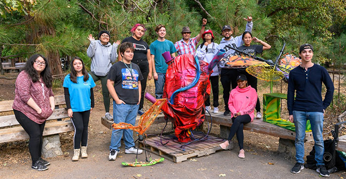 Students pose with their trash-to-art sculptures in Yosemite National Park.